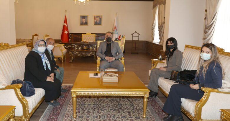 NEVKAD ve NEVUMUT dernekleri başkanı Atlı Başkan Savran'ı ziyaret etti
